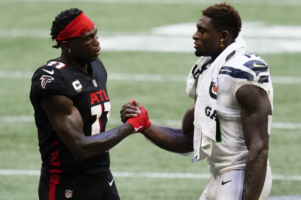 Atlanta Falcons wide receiver Julio Jones (11) and Seattle Seahawks wide receiver DK Metcalf (14) speak after the second half of an NFL football game, Sunday, Sept. 13, 2020, in Atlanta. The Seattle Seahawks won 38-25. (AP Photo/Brynn Anderson)