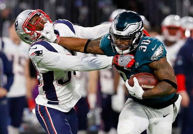 <p>Corey Clement #30 of the Philadelphia Eagles runs the ball past Duron Harmon #30 of the New England Patriots for a 55-yard gain during the second quarter in Super Bowl LII at U.S. Bank Stadium on February 4, 2018 in Minneapolis, Minnesota. (Photo by Kevin C. Cox/Getty Images) </p>
