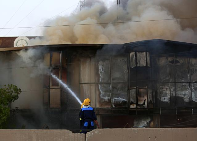 <p>A firefighter sprays water into the burning provincial government building during anti-government protests in Basra, 340 miles (550 km) southeast of Baghdad, Iraq, Thursday, Sept. 6, 2018. Iraqi protesters stormed and set fire to a provincial government building in the southern city of Basra, despite a curfew imposed by authorities Thursday to try and quell demonstrations against poor public services and unemployment that have turned violent. (Photo: Nabil al-Jurani/AP) </p>