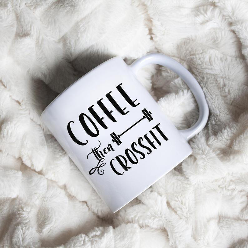 """<p>Because the two go hand-in-hand for many CrossFitters, they'll appreciate this adorable <a href=""""https://www.popsugar.com/buy/coffee-CrossFit-mug-513540?p_name=coffee%20and%20CrossFit%20mug&retailer=etsy.com&pid=513540&price=15&evar1=fit%3Auk&evar9=46864615&evar98=https%3A%2F%2Fwww.popsugar.com%2Ffitness%2Fphoto-gallery%2F46864615%2Fimage%2F46866746%2FCoffee-Than-CrossFit-Mug&prop13=api&pdata=1"""" rel=""""nofollow"""" data-shoppable-link=""""1"""" target=""""_blank"""" class=""""ga-track"""" data-ga-category=""""Related"""" data-ga-label=""""https://www.etsy.com/listing/579302194/coffee-then-crossfit-coffee-mug-crossfit?ga_order=most_relevant&amp;ga_search_type=all&amp;ga_view_type=gallery&amp;ga_search_query=crossfit+mug&amp;ref=sc_gallery-1-2&amp;plkey=30f8f329c0d3a1e36a3944e853e24fb013ae75a6%3A579302194"""" data-ga-action=""""In-Line Links"""">coffee and CrossFit mug</a> ($15-$18).</p>"""