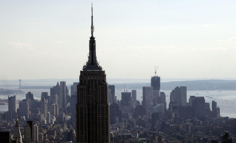 FILE - This Aug. 30, 2011, file photo, shows the Empire State Building in an aerial view of the Manhattan skyline in New York. The Empire State building was New York's tallest from 1931-1972, until the completion of the World Trade Center. It became the tallest once again when two planes crashed into the World Trade Center in a terrorist attack, causing the twin 110-story towers to collapse on Sept. 11, 2001. On Monday, April 30, 2012, One World Trade Center _ being built to replace the twin towers destroyed on 9/11 _ gets steel columns to make its unfinished framework a little higher than the Empire State Building's observation deck, to become the tallest building in New York. (AP Photo/Mark Lennihan, File)