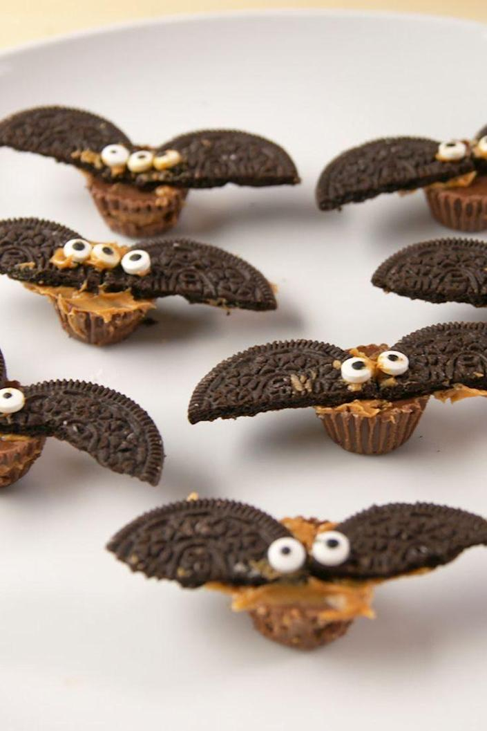 """<p>These super tasty, super cute bats are deceptively easy to make, and they'll delight all the guests at your Halloween party. </p><p><strong><em>Get the recipe at <a href=""""https://www.delish.com/cooking/recipe-ideas/recipes/a56043/reeses-bats-recipe/"""" rel=""""nofollow noopener"""" target=""""_blank"""" data-ylk=""""slk:Delish"""" class=""""link rapid-noclick-resp"""">Delish</a>. </em></strong></p><p><strong>__________________________________________________________</strong><br><br><em>Want more recipes? </em><a href=""""https://subscribe.hearstmags.com/subscribe/womansday/253396?source=wdy_edit_article"""" rel=""""nofollow noopener"""" target=""""_blank"""" data-ylk=""""slk:Subscribe to Woman's Day"""" class=""""link rapid-noclick-resp""""><em>Subscribe to Woman's Day</em></a><em> today and get </em><em>73% off your first 12 issues</em><em>. And while you're at it, </em><a href=""""https://link.womansday.com/join/3o9/wdy-newsletter"""" rel=""""nofollow noopener"""" target=""""_blank"""" data-ylk=""""slk:sign up for our FREE newsletter"""" class=""""link rapid-noclick-resp""""><em>sign up for our FREE newsletter</em></a><em> for even more of the Woman's Day content you want.</em><br></p>"""