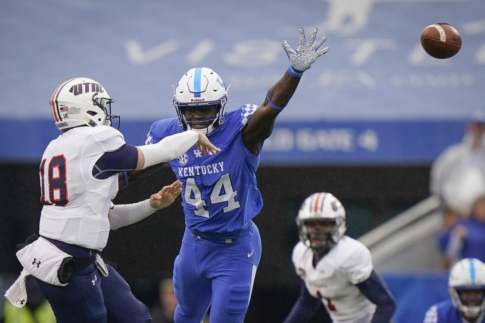 FILE - Kentucky linebacker Jamin Davis (44) rushes UT Martin quarterback John Bachus III (18) during the first half of an NCAA college football game in Lexington, Ky., in this Saturday, Nov. 23, 2019, file photo. Davis is a possible first round pick in the NFL Draft, April 29-May 1, 2021, in Cleveland. (AP Photo/Bryan Woolston, FIle)