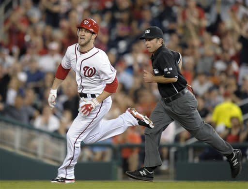 Washington Nationals Bryce Harper heads to second base on an RBI double against the Arizona Diamondbacks in the sixth inning of a baseball game at Nationals Park in Washington, Thursday, May 3, 2012. (AP Photo/Susan Walsh)