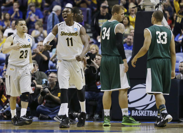 Wichita State forward Cleanthony Early (11) celebrates against Cal Poly during the first half of a second-round game in the NCAA college basketball tournament Friday, March 21, 2014, in St. Louis. (AP Photo/Jeff Roberson)