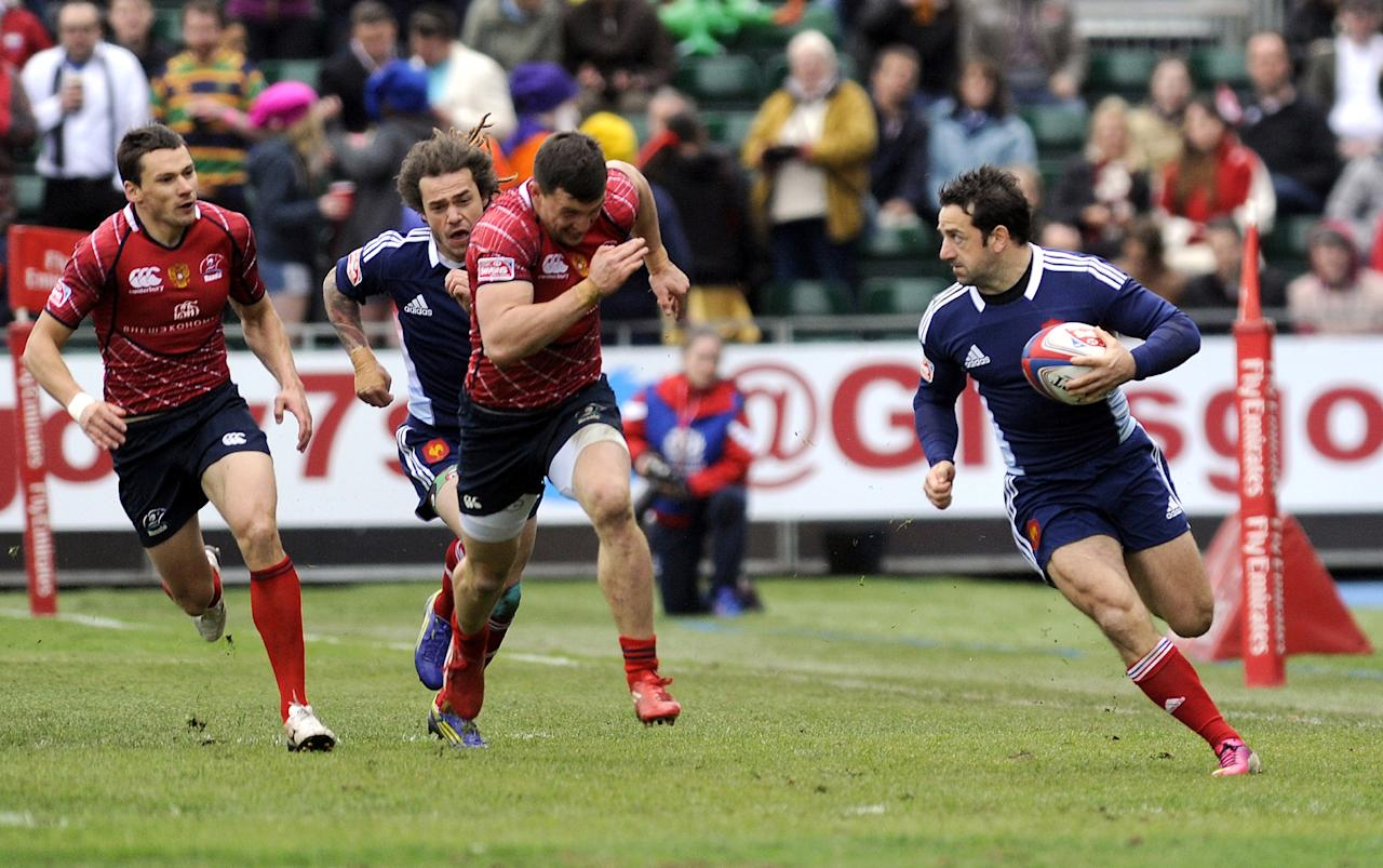 Julien Candelon (R) of France runs with the ball against Russia during their Rugby Union Glasgow Sevens game at Scotstoun Stadium in Glasgow, Scotland, on May 4, 2013. France won the game 15-14. AFP PHOTO/ANDY BUCHANANAndy Buchanan/AFP/Getty Images