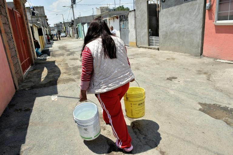 Residents of Iztapalapa, Mexico City have to carry water home in buckets due to a lack of infrastructure