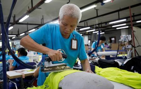 Hoang Van The, 52, who joined X40 garment company and now Maxport since 1987, works at Maxport garment company in Hanoi