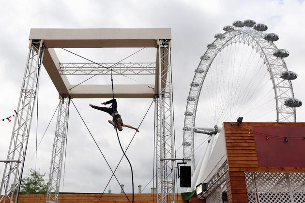 'Mozes' practices his trapeze routine at the Priceless London Wonderground at the Southbank Centre on July 19, 2012 in London, England. The performance is one of many that is taking place at the Priceless London Wonderground, next to Jubilee Gardens, which opens on July 20, 2012 and runs until September 29, 2012.  (Photo by Oli Scarff/Getty Images)