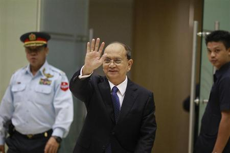 Myanmar's President Thein Sein waves as he arrives at Yangon International Airport after returning from the U.S.