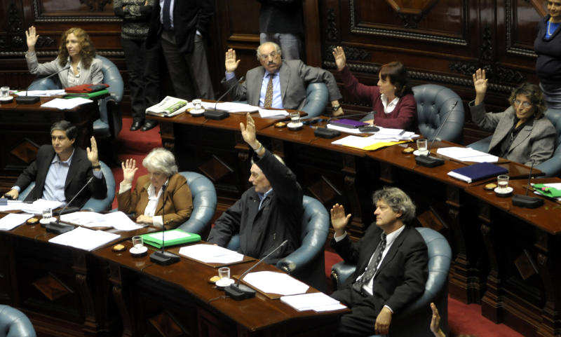 Uruguayan senators of the ruling party Frente Amplio vote in favor of legalizing abortion in Montevideo, Uruguay,Wednesday, Oct. 17, 2012. The Uruguayan Senate on Wednesday voted to legalize all first trimester abortions in a groundbreaking step in Latin America. (AP Photo/Matilde Campodonico)