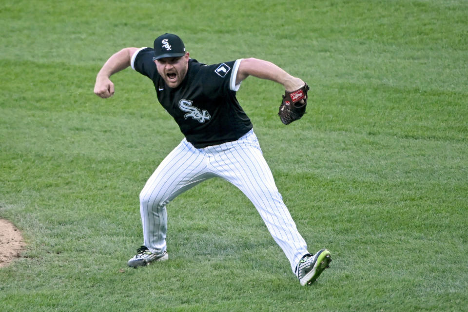 Chicago White Sox relief pitcher Liam Hendriks (31) reacts after winning the second baseball game of a doubleheader against the Baltimore Orioles, Saturday, May 29, 2021, in Chicago. (AP Photo/Matt Marton)