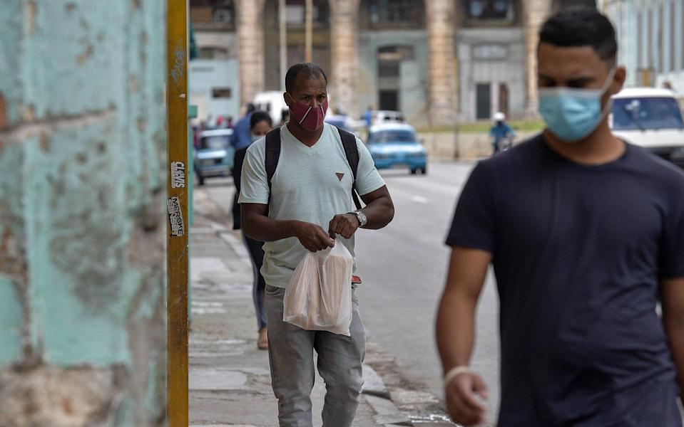 Masks are mandatory on the streets of Havana - Getty