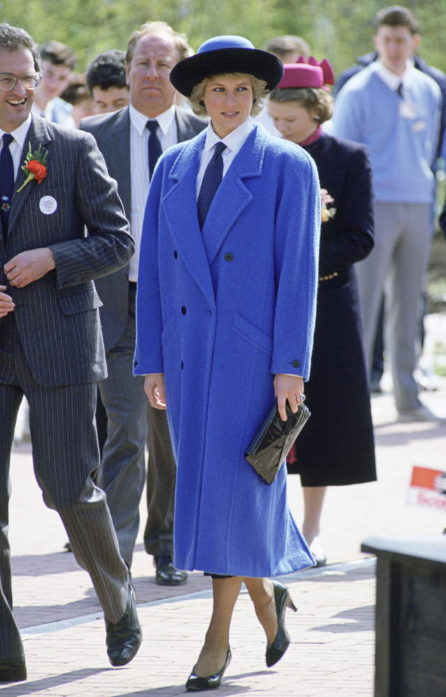 <p>Diana bucked the frilly princess style by embracing menswear, including ties, button-down shirts, and menswear-style coats. (Photo: Tim Graham/Getty Images) </p>