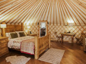 """<p><span>To switch off from daily stresses, book </span><a href=""""http://www.sykescottages.co.uk/cottage/Peak-District-Peak-District-Derbyshire-Dales-Hepworth/The-Rowan-Yurt-917044.html"""" rel=""""nofollow noopener"""" target=""""_blank"""" data-ylk=""""slk:this secluded yurt in Hepworth"""" class=""""link rapid-noclick-resp""""><span>this secluded yurt in Hepworth</span></a><span>, not far from the Peak District and Yorkshire Dales. Inside there's no wi-fi, TV or phone, but there are oodles of homely and romantic features such as a wood-burning stove and private hot tub. There's a lovely pub nearby and walks start straight from your doorstep. Three nights from £383. [Photo: Skyes Cottages]</span> </p>"""