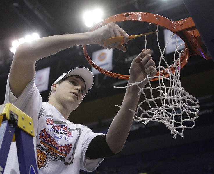 Creighton's Doug McDermott helps cut down the net after defeating Wichita State 68-65 for the Missouri Valley Conference tournament championship in an NCAA college basketball game on Sunday, March 10, 2013, in St. Louis. McDermott was named tournament Most Valuable Player. (AP Photo/Tom Gannam)