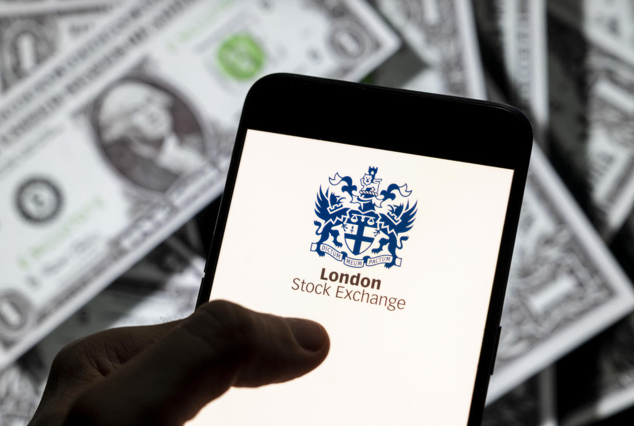 CHINA - 2021/04/14: In this photo illustration, the British London Stock Exchange index logo is seen on an Android mobile device screen with the currency of the United States dollar icon, $ icon symbol in the background. (Photo Illustration by Chukrut Budrul/SOPA Images/LightRocket via Getty Images)