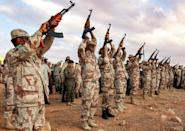 Violence has riven the North African nation since 2011; this November 01, 2020 picture shows fighters firing during a funeral