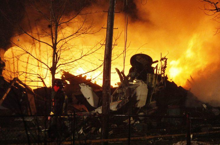 A Continental Airlines plane burns after it crashed into a house in Clarence Center, N.Y. on Feb. 12, 2009.