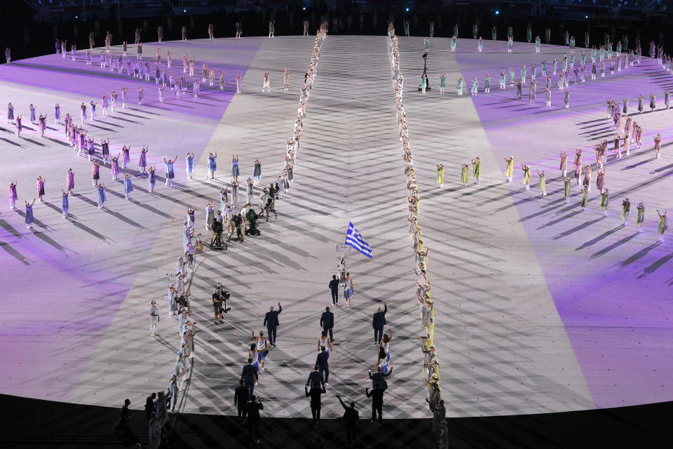 <p>TOKYO, JAPAN - JULY 23: Flag bearers Anna Korakaki and Eleftherios Petrounias of Team Greece lead their teammates out during the Opening Ceremony of the Tokyo 2020 Olympic Games at Olympic Stadium on July 23, 2021 in Tokyo, Japan. (Photo by Ezra Shaw/Getty Images)</p>