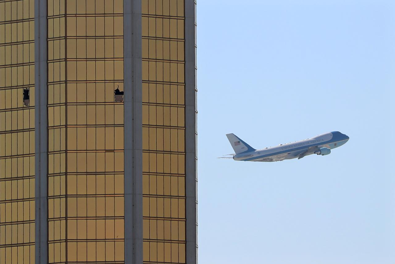 <p>Air Force One departs Las Vegas past the broken windows on the Mandalay Bay hotel, where shooter Stephen Paddock conducted his mass shooting along the Las Vegas Strip in Las Vegas, Nev., Oct. 4, 2017. (Photo: Kevin Lamarque/Reuters) </p>