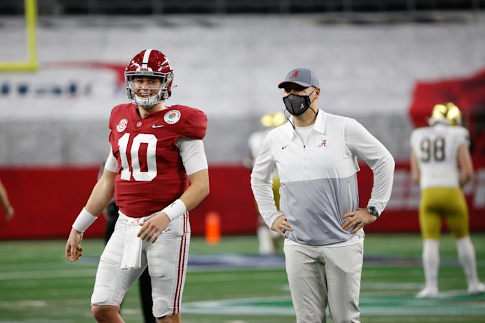DALLAS, TX - JANUARY 1: Mac Jones #10 and Steve Sarkisian of the Alabama Crimson Tide before the game against the Notre Dame Fighting Irish in the Rose Bowl College Football Playoff Semifinal game at AT&T Stadium on January 1, 2021 in Dallas, Texas. (Photo by UA Athletics/Collegiate Images/Getty Images)