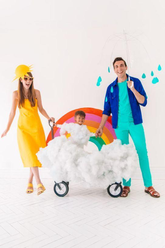 """<p>Rain or shine, this family costume will melt everyone's heart. The little rainbow can be lugged around in wheels, which makes trick-or-treating a little easier.</p><p><em><a href=""""https://studiodiy.com/2018/10/15/diy-family-weather-costume/"""" rel=""""nofollow noopener"""" target=""""_blank"""" data-ylk=""""slk:Get the tutorial at Studio DIY »"""" class=""""link rapid-noclick-resp"""">Get the tutorial at Studio DIY »</a></em></p><p><strong>RELATED: </strong><a href=""""https://www.goodhousekeeping.com/holidays/halloween-ideas/g28073110/halloween-costumes-for-3-people/"""" rel=""""nofollow noopener"""" target=""""_blank"""" data-ylk=""""slk:30 Best Halloween Costumes for 3 People That Are Trio Goals"""" class=""""link rapid-noclick-resp"""">30 Best Halloween Costumes for 3 People That Are Trio Goals</a></p>"""