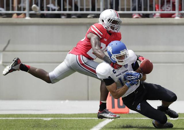 Ohio State cornerback Armani Reeves, left, knocks the ball away from Buffalo wide receiver Alex Neutz during the second quarter of an NCAA college football game Saturday, Aug. 31, 2013, in Columbus, Ohio. (AP Photo/Jay LaPrete)
