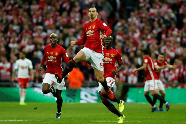 Manchester United's Swedish striker Zlatan Ibrahimovic (centre) celebrates scoring a goal during the English League Cup final match against Southampton at Wembley stadium in north London on February 26, 2017