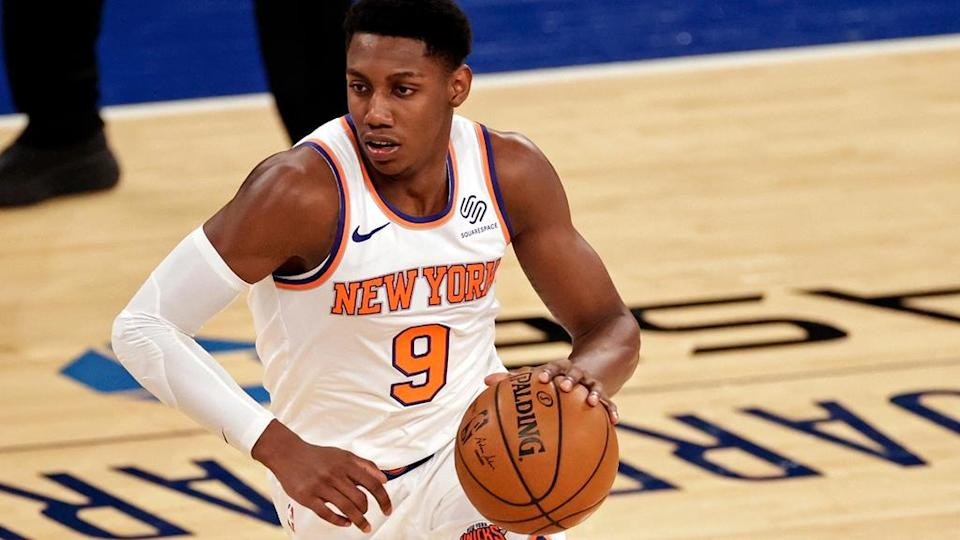 Mar 18, 2021; New York, New York, USA; New York Knicks guard RJ Barrett (9) drives to the basket against the Orlando Magic forward during the first half of an NBA basketball game Thursday, March 18, 2021, in New York.