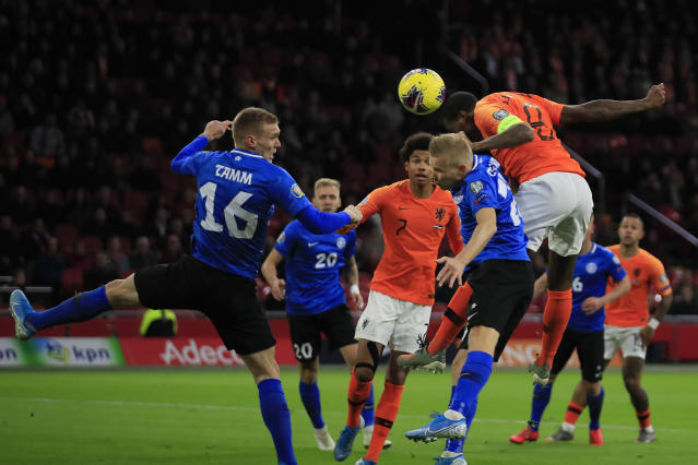 Netherlands' Georginio Wijnaldum, right, scores his side's first goal during the Euro 2020 group C qualifying soccer match between The Netherlands and Estonia at the Johan Cruyff ArenA in Amsterdam, Netherlands, Tuesday, Nov. 19, 2019. Left is Estonia's Joonas Tam. (AP Photo/Peter Dejong)