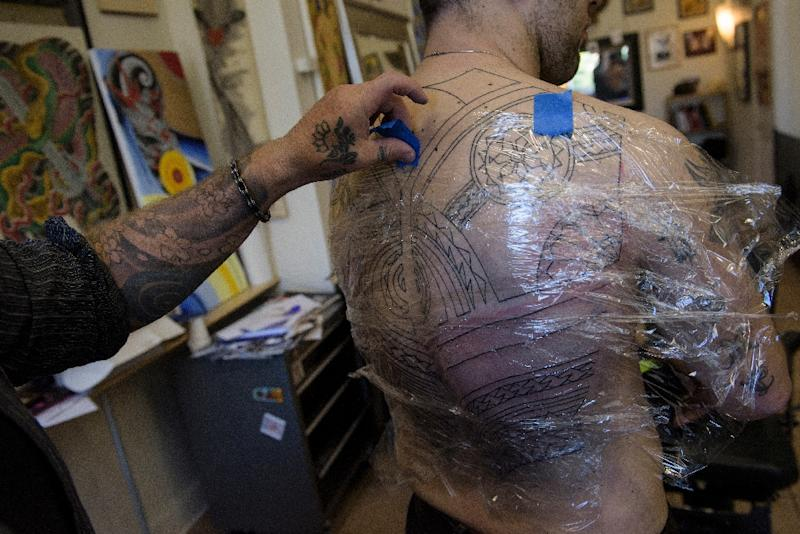 The US Navy has eased restrictions on tattoos to widen its pool of recruits (AFP Photo/Brendan Smialowski)