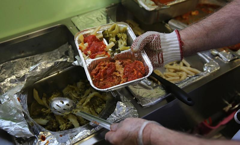 A Catholic Services worker prepares Meals on Wheels lunch delivery on March 12, 2014 in Franklin, New Jersey: John Moore/Getty