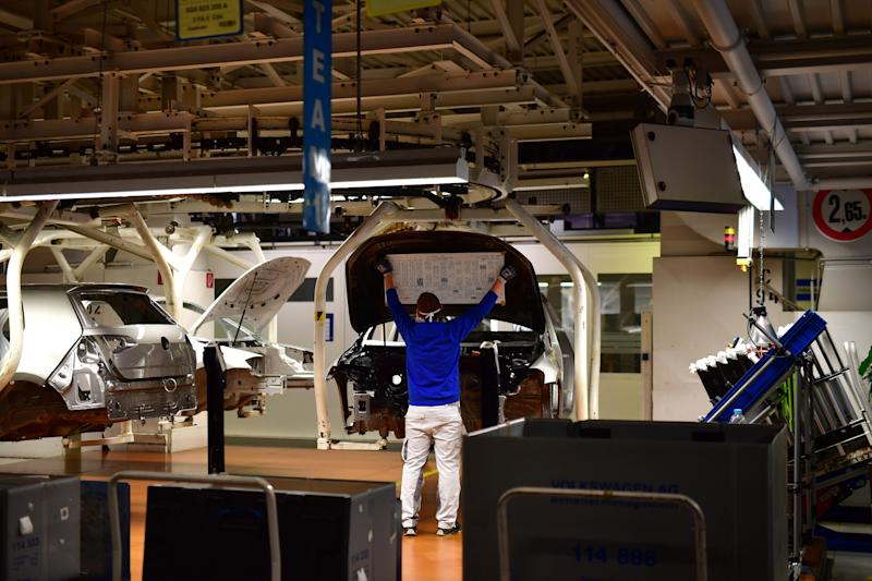 WOLFSBURG, GERMANY - APRIL 27: Workers wear face masks while working on the car assembly line on the first day of the resumption of automobile production at the Volkswagen factory during the coronavirus crisis on April 27, 2020 in Wolfsburg, Germany. Production was shut down in March due to both to lockdown measures designed to stem the spread of the virus and the breakdown of international supply chains. Germany is taking steps to lift lockdown measures in a careful attempt to get the economy back into gear. (Photo by Alexander Koerner/Getty Images)