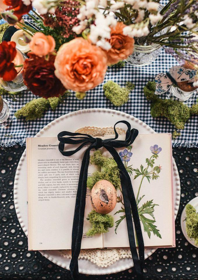 "<p>A vintage flower almanac, speckled egg, and velvet bow make this the easily replicated Easter table setup of our dreams. </p><p><strong>Get the tutorial at <a rel=""nofollow"" href=""https://www.onecrafdiygirl.com/spring-table-setting-easy-easter-owl-egg-diy/"">One CrafDIY Girl</a>. </strong></p><p><strong><a rel=""nofollow"" href=""https://www.amazon.com/LaRibbons-Crushed-Velvet-Ribbons-Yards/dp/B01N1ZIW00/"">SHOP VELVET RIBBON</a><br></strong></p>"