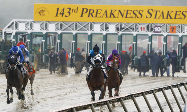Four horses leave the gate in the second race ahead of the 143rd Preakness Stakes horse race at Pimlico race course, Saturday, May 19, 2018, in Baltimore. Eight horses scratched before this race. (AP Photo/Steve Helber)