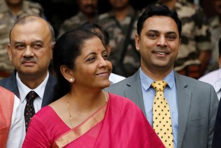 FILE PHOTO: India's Finance Minister Nirmala Sitharaman (C) and Krishnamurthy Subramanian (R), chief economic adviser, pose outside their office before the presentation of the federal budget