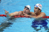Chase Kalisz, left, of the United States, celebrates with teammate Jay Litherland after winning the final of the men's 400-meter individual medley at the 2020 Summer Olympics, Sunday, July 25, 2021, in Tokyo, Japan. (AP Photo/Petr David Josek)
