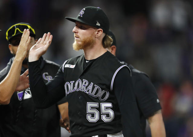 Teammates congratulate Colorado Rockies starting pitcher Jon Gray after a baseball game against the Los Angeles Dodgers, Monday, July 29, 2019, in Denver. The Rockies won 9-1. (AP Photo/David Zalubowski)