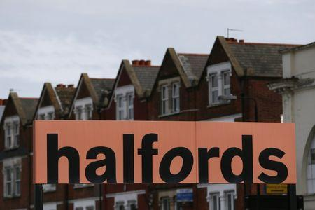 A Halfords sign is seen outside a store in London, Britain April 10, 2016. REUTERS/Stefan Wermuth