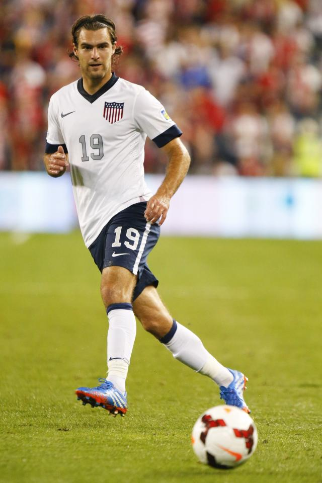 KANSAS CITY, KS - OCTOBER 11: Graham Zusi #19 of the U.S. Men's National Soccer Team passes the ball against Jamaica early in the second half at Sporting Park on October 11, 2013 in Kansas City, Kansas. (Photo by Kyle Rivas/Getty Images)