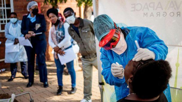 PHOTO: Doctors Without Borders (MSF) nurse Bhelekazi Mdlalose, 51, performs a swab test for COVID-19 coronavirus on a health worker at the Vlakfontein Clinic in Lenasia, Johannesburg, May 13, 2020. (AFP via Getty Images, FILE)
