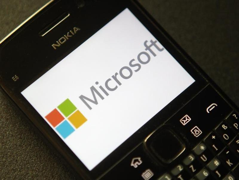 A photo illustration shows the Microsoft logo displayed on a Nokia phone in Vienna