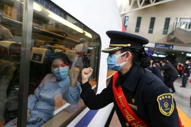 The virus has claimed more than 1,500 lives and infected some 66,000 people in China (AFP Photo/STR)