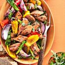 <p>Adding a bright parsley-tarragon vinaigrette brings fresh flair to sausage and peppers. Serve with some crusty bread to sop it all up.</p>