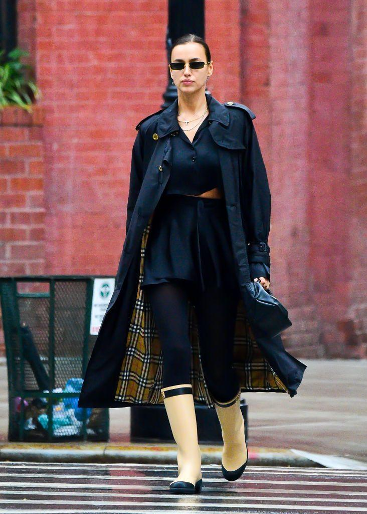 """<p>Once again <a href=""""https://www.elle.com/uk/fashion/a28080681/irina-shayk-lea-de-seine-shayk-cooper-matching-burberry/"""" rel=""""nofollow noopener"""" target=""""_blank"""" data-ylk=""""slk:twinning in Burberry with her daughter"""" class=""""link rapid-noclick-resp"""">twinning in Burberry with her daughter</a>, Irina Shayk stepped out for the school run in an epic designer ensemble.</p><p>The 34 year-old paired her Burberry trench coat with a pair of <a href=""""https://www.elle.com/uk/fashion/trends/a34367206/welly-boot-trend/"""" rel=""""nofollow noopener"""" target=""""_blank"""" data-ylk=""""slk:Chanel Wellington boots"""" class=""""link rapid-noclick-resp"""">Chanel Wellington boots</a>.</p><p>Finishing of the rain-ready look the mum wore a <a href=""""https://www.net-a-porter.com/en-gb/shop/designer/orseund-iris"""" rel=""""nofollow noopener"""" target=""""_blank"""" data-ylk=""""slk:Orseund Iris"""" class=""""link rapid-noclick-resp"""">Orseund Iris</a> two-piece that fellow model <a href=""""https://www.elle.com/uk/fashion/celebrity-style/g34517348/emily-ratajkowski-pregnancy-style/?slide=9"""" rel=""""nofollow noopener"""" target=""""_blank"""" data-ylk=""""slk:Emily Ratajkowski owns in ivory"""" class=""""link rapid-noclick-resp"""">Emily Ratajkowski owns in ivory</a>, with a Demellier Los Angeles bag.</p><p><a class=""""link rapid-noclick-resp"""" href=""""https://go.redirectingat.com?id=127X1599956&url=https%3A%2F%2Fuk.burberry.com%2Fthe-westminster-heritage-trench-coat-p80280931&sref=https%3A%2F%2Fwww.elle.com%2Fuk%2Ffashion%2Fcelebrity-style%2Fg34359706%2Firina-shayk-style-file%2F"""" rel=""""nofollow noopener"""" target=""""_blank"""" data-ylk=""""slk:SHOP IRINA'S BURBERRY TRENCH NOW"""">SHOP IRINA'S BURBERRY TRENCH NOW</a></p>"""