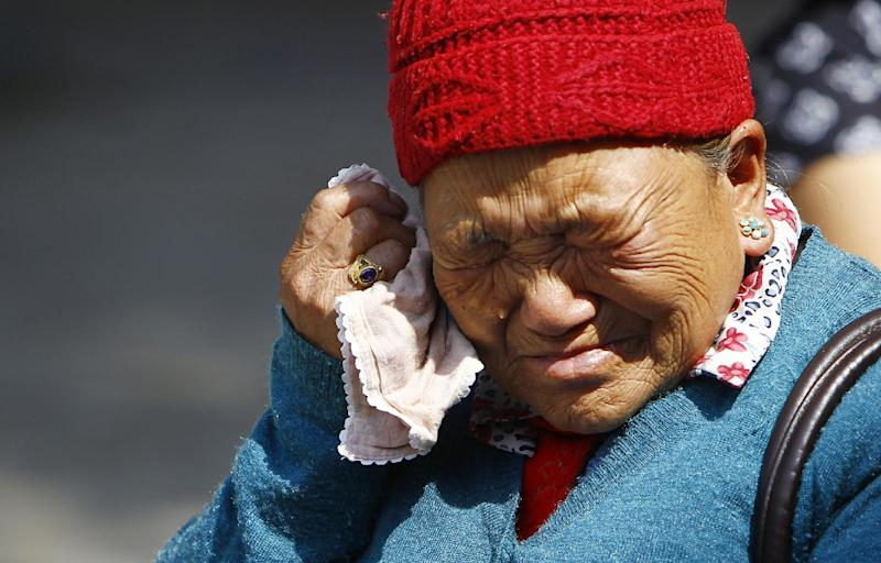 Mother of Nepalese mountaineer Ang Kaji Sherpa, killed in an avalanche on Mount Everest, cries while she waits for his body at Sherpa Monastery in Katmandu, Nepal, Saturday, April 19, 2014. Rescuers were searching through piles of snow and ice on the slopes of Mount Everest on Saturday for four Sherpa guides who were buried by an avalanche that killed 12 other Nepalese guides in the deadliest disaster on the world's highest peak. The Sherpa people are one of the main ethnic groups in Nepal's alpine region, and many make their living as climbing guides on Everest and other Himalayan peaks. (AP Photo/Niranjan Shrestha)