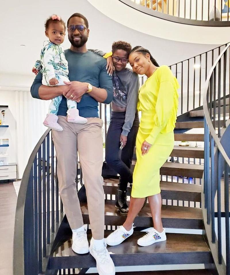 Gabrielle Union (R) and Dwyane Wade with their kids Kaavia and Zion