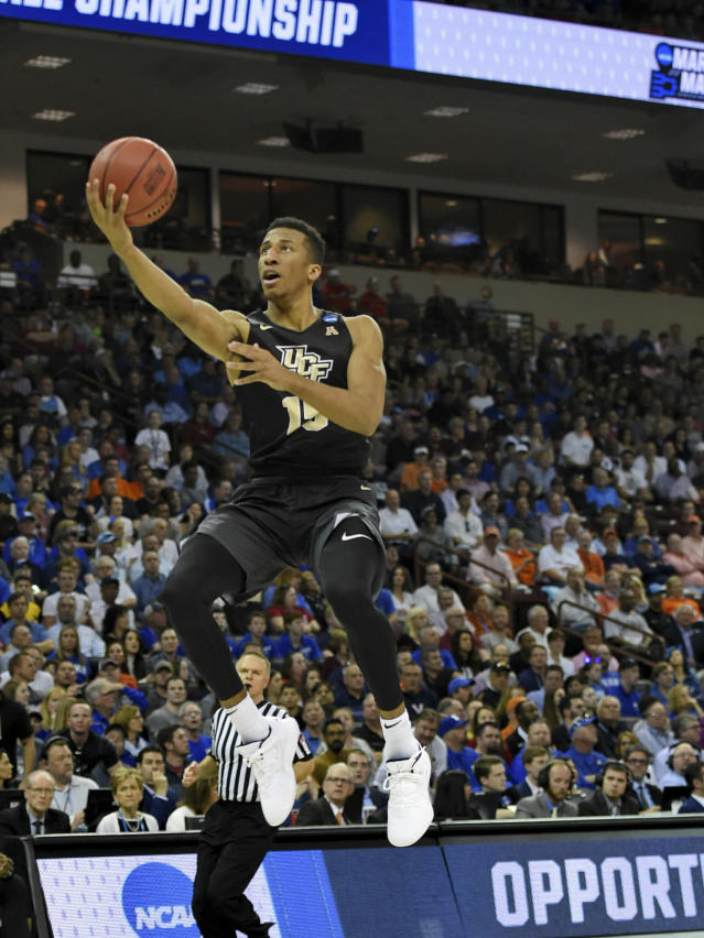 Central Florida's Aubrey Dawkins drives in for a layup during the first half of a first round men's college basketball game against Duke in the NCAA Tournament in Columbia, S.C. Sunday, March 24, 2019. (AP Photo/Richard Shiro)