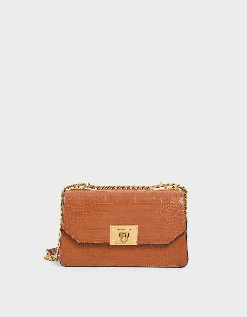 <p>Gift this <span>Charles &amp; Keith Cognac Croc-Effect Chain Strap Crossbody Bag</span> ($73) to your fashion-loving best friend.</p>